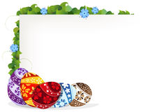Easter eggs and blue wildflowers Stock Photos