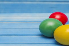 Easter eggs on blue wooden background Stock Photography