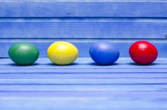 Easter eggs on blue wooden background Royalty Free Stock Photo