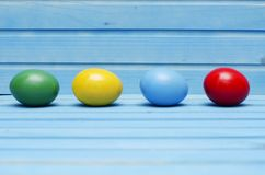 Easter eggs on blue wooden background Stock Images