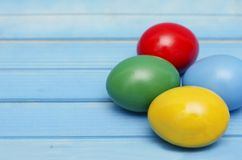 Easter eggs on blue wooden background Royalty Free Stock Photos