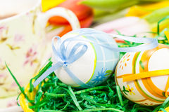 Easter eggs.with blurred tulips and cup of coffee Royalty Free Stock Images