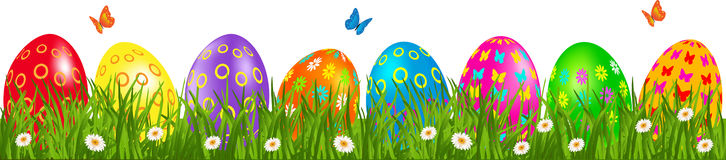 Easter eggs border with daisies. Easter eggs border with multicolored eggs in a grass with daisy and butterfly Royalty Free Stock Photos