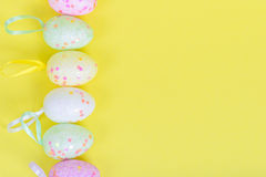 Easter eggs for border or frame closeup Stock Images
