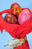 Easter eggs bouquet. Some easter eggs of different colors on a bouquet on a blue background Royalty Free Stock Images
