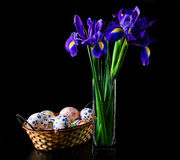 Easter eggs with bouquet of iris Royalty Free Stock Image