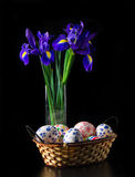 Easter eggs with bouquet of iris Royalty Free Stock Photography