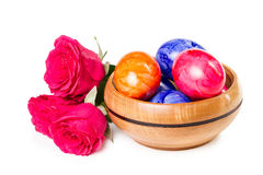 Easter eggs with a bouquet of roses Stock Photos