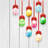 Easter eggs with bow on wooden background Royalty Free Stock Images