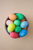 Easter eggs in a bowl on a beige background Royalty Free Stock Photo