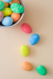 Easter eggs in a bowl on a beige background Royalty Free Stock Photography
