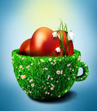 Easter eggs in bowl from grass and camomiles Stock Images
