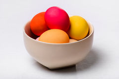 Easter eggs in a bowl on the white cloth Royalty Free Stock Photos