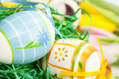 Easter eggs with bows in the basket Stock Image