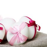 Easter Eggs with Bows Close on White Stock Image