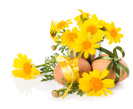 Easter eggs with bows and flowers Royalty Free Stock Photos