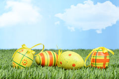 Easter eggs with bows in grass Royalty Free Stock Images