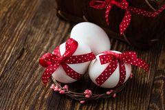 Easter eggs with bows Stock Photo