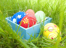 Easter eggs in the box. And in the grass Stock Image
