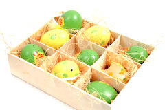 Easter eggs in a box. 9 colored easter eggs in a box stock photography