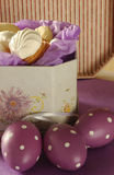 Easter eggs and box of biscuits Royalty Free Stock Photography