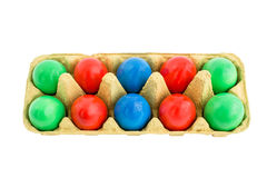 Easter eggs in box isolated over white Royalty Free Stock Photos