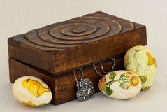 Easter eggs and box with a silver heart Royalty Free Stock Images