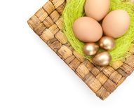 Easter eggs are on braided plate Royalty Free Stock Images