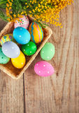 Easter eggs with branch of mimosa flowers Stock Image