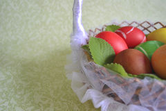 Easter eggs on the branches of mint stock images