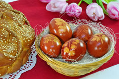 Easter eggs, bread, tulips Royalty Free Stock Image