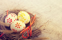 Easter eggs with bright tapes in a nest Royalty Free Stock Images