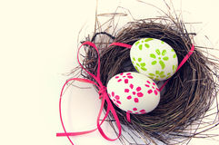 Easter eggs with bright tapes in a nest Royalty Free Stock Photo