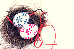 Easter eggs with bright tapes in a nest Stock Photo