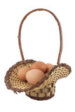 Easter eggs in brown basket Stock Images