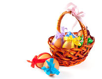 Easter eggs in brown basket Royalty Free Stock Photo