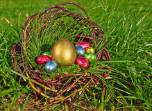 Easter eggs in brown basket Stock Photo