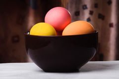 Easter eggs in a brown bowl Royalty Free Stock Photo