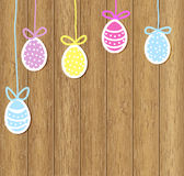 Easter eggs on a brown wooden background. Painted colored Easter eggs on a wooden background royalty free illustration