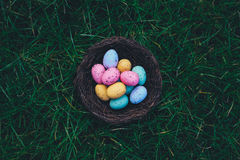 Easter Eggs on Brown Woven Basket Stock Images