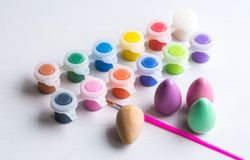 Easter eggs with brush and paint. Wooden easter eggs with brush and paint Stock Photography