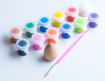 Easter eggs with brush and paint. Wooden easter eggs with brush and paint Royalty Free Stock Photo