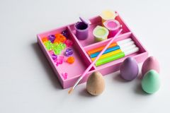 Easter eggs with brush and paint. Wooden easter eggs with brush and paint Stock Photo