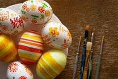 Easter eggs and brushes. On wooden background Stock Images