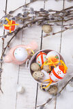 Easter eggs in bucket, decorative bird and willow  branches Stock Image