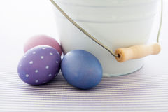 Easter eggs and bucket Stock Images