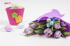 Easter eggs with bucket and tulips Royalty Free Stock Image