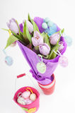 Easter eggs with bucket and tulips Stock Photo