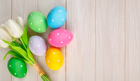 Easter eggs with bunch of tulip flowers Stock Image