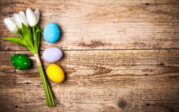 Easter eggs with bunch tulips copyspace Royalty Free Stock Photo